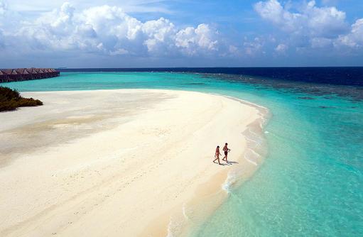 Strandspaziergang zum Schnorcheln, Anantara Kihavah Villas, Maldives