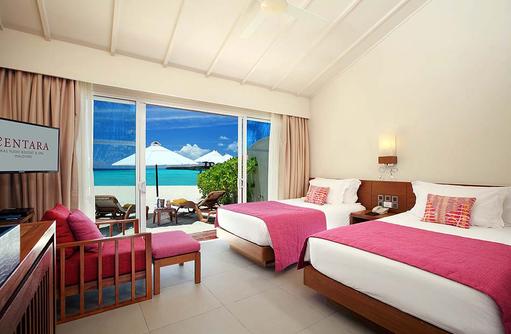 Ocean Front Beach Villa, Schlafzimmer mit zwei Betten, Centara Ras Fushi Resort & Spa, Maldives