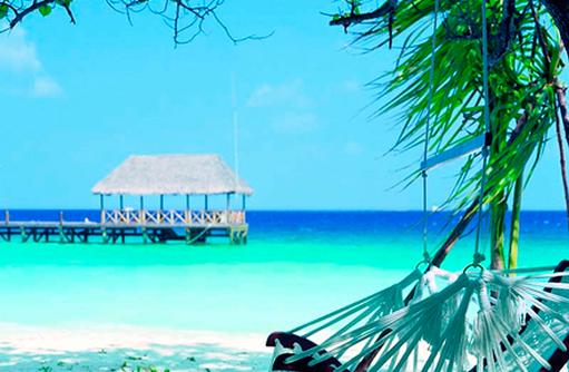 Hängeschaukel am Strand, Cocoa Island by Como, Malediven