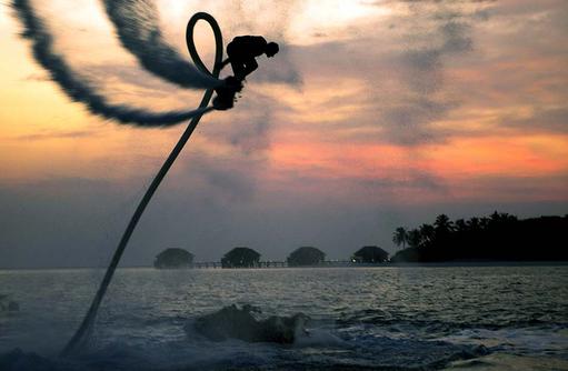 Flyboarding, Sunset, Conrad Maldives Rangali Island, Maldives