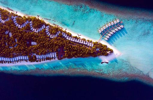 Vogelperspektive auf die Wasservillen, Dhigali Maldives