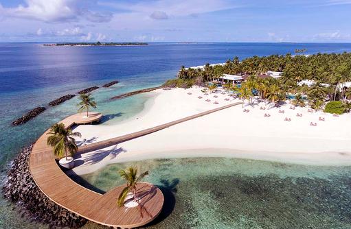 Strand mit Steg, Dhigali Maldives