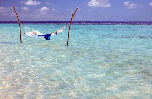 Hängematte in der Lagune, Dusit Thani Maldives