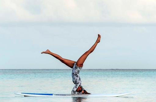 Stand-up Paddle Yoga, Four Seasons Resort Maldives at Kuda Huraa
