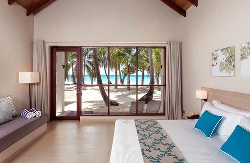Beach Villa direkt am Strand, Malahini Kuda Bandos, Malediven
