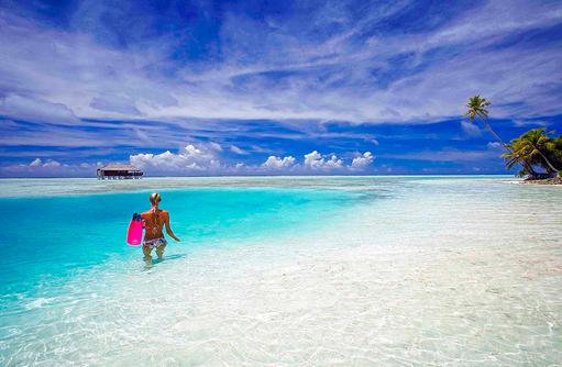 Schnorcheln direkt vom Strand aus, Medhufushi Island Resort, Maldives