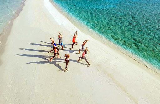 Aerobic am Strand, One & Only Reethi Rah, Maldives