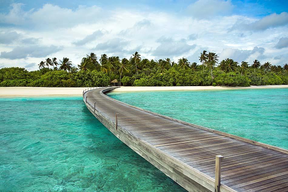 Steg zum Strand, COMO Maalifushi, Maldives